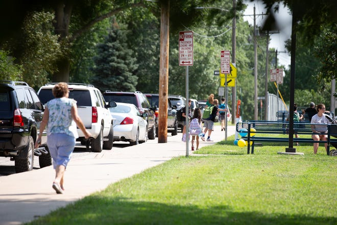 Cars line the block around Whitson Elementary School last week as students are released from their first day back to school.
