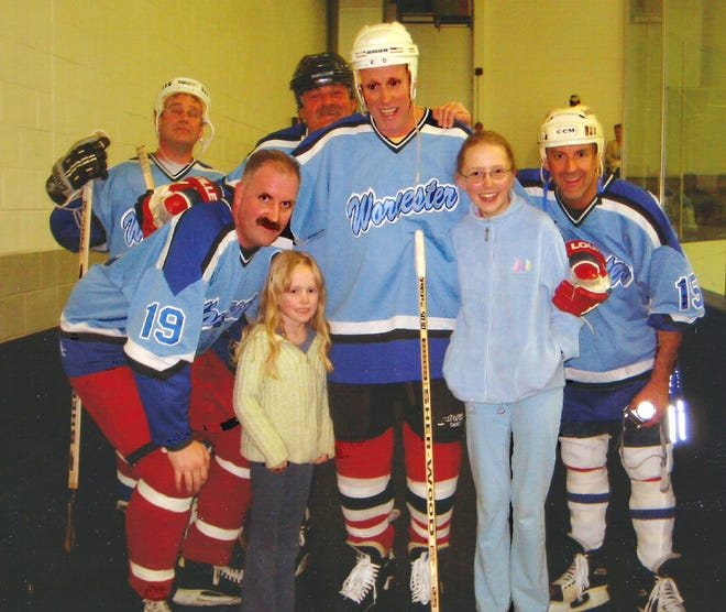 Phil Coleman, center, was always surrounded by family and friends at the rink. In this case, daughters Sylvia and Colleen, and teammates, from left, John O'Coin, Peter Cahill, Bruce Scola and Mike Gervais.
