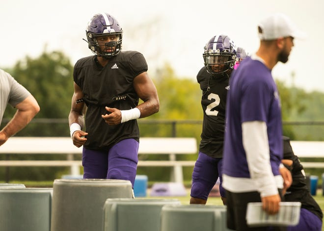 Holy Cross defensive lineman Benton Whitley takes part in drills during practice Tuesday in Worcester.