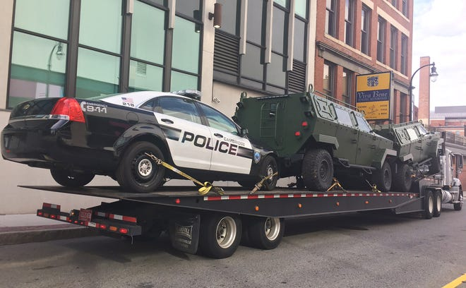 Vehicles were dropped off on Commercial Street in downtown Worcester Tuesday afternoon.