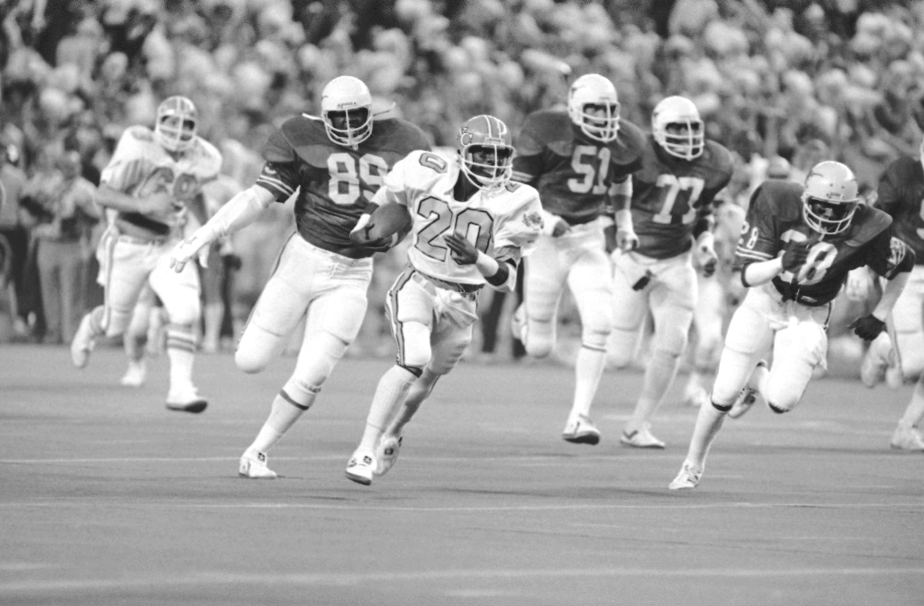 """Former Norfolk Lake Taylor High School running back Amos Lawrence (20), pictured here in the 1980 Bluebonnet Bowl against Texas, is one of the top 757 players in UNC football history. Nicknamed """"Famous Amos,"""" he's one of seven players in college football history to rush for 1,000 yards in four straight seasons and also holds UNC's all-time rushing yardage record."""