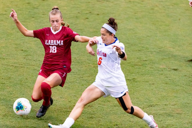 """Florida Gators forward Kit Loferski (6) blocks out Alabama Crimson Tide midfielder Felicia Knox (18) during a game in Gainesville on Oct. 4, 2020. Loferski is expected to play a major role for the Gators in 2021. """"Kit has been dangerous in attack,"""" new head coach Tony Amato said. [FILE]"""