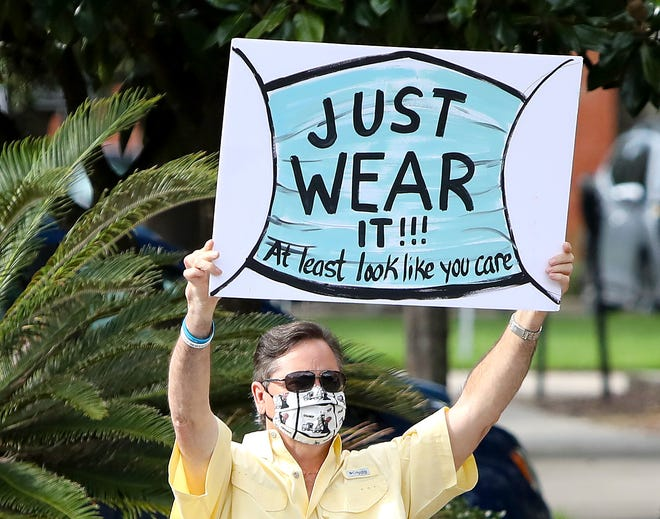 Protesters supporting a mask mandate in Alachua County Public Schools voice their opinions at the corner of Northwest First Street and University Avenue in Gainesville on Aug. 17.