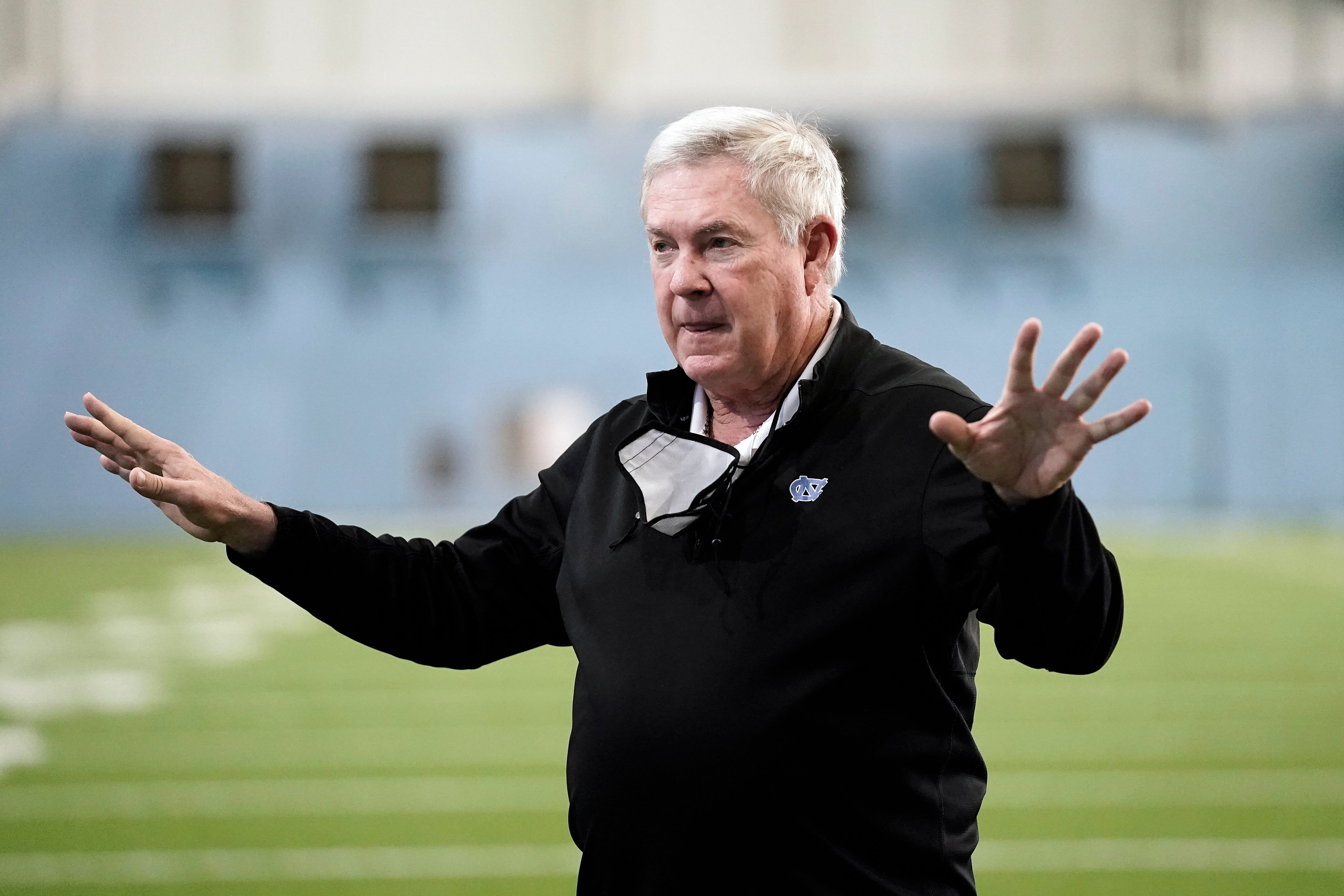 Mack Brown speaks prior to North Carolina's pro day workout activities for NFL scouts and coaches in March.