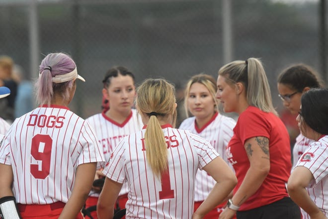 Centennial High School head softball coach Erica Ortiz (right) talks to her team between innings during  the Bulldogs' 2021 season opener on Tuesday, August 17, 2021 at Salas Field. [Chieftain photo/Jeff Letofsky]