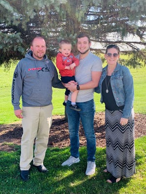 Laura Starfeldt, who is the honorary survivor for Saturday's Sole Burner 5K Run/Walk, with her (from left) husband Brian, son Bennett and son Blake.