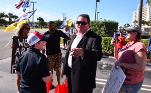 Both republican supporters and democratic  critics showed up outside the Hilton Melbourne Beach Oceanfront Wednesday afternoon where State Representative Randy Fine was kicking off his final campaign for Florida House.  It was a battle of the megaphones outside. Randy Fine came out before his event and gave out cold bottles of water.