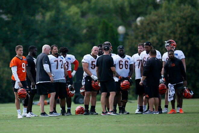 Cincinnati Bengals head coach Zac Taylor talks with the offense near the end of practice during a training camp practice at the Paul Brown stadium practice facility in downtown Cincinnati on Wednesday, Aug. 18, 2021.