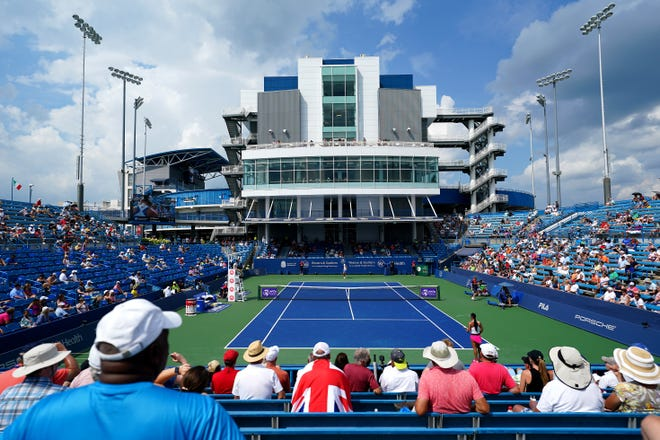 Tennis fans watch the match between Ashleigh Barty, of Australia, and Heather Watson, of Great Britain, Wednesday, Aug. 18, 2021, during the Western & Southern Open tennis tournament at the Lindner Family Tennis Center in Mason, Ohio.