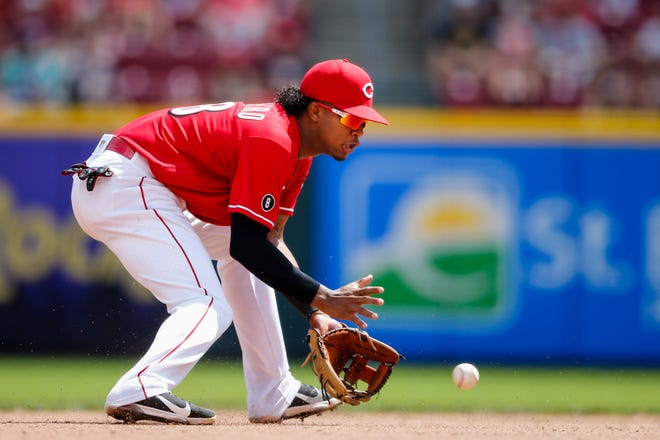 Cincinnati Reds shortstop Jose Barrero (38) stops a ground ball to make a double play in the seventh inning of the MLB National League game between the Cincinnati Reds and Chicago Cubs on Wednesday, Aug. 18, 2021, at Great American Ball Park in downtown Cincinnati.