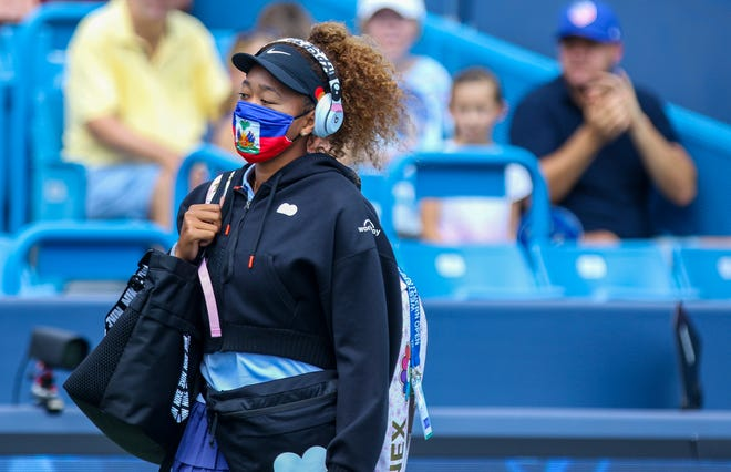 Naomi Osaka enters Center Court during the Western & Southern Open at the Lindner Family Tennis Center Wednesday, August 18, 2021 to face Cori Gauff of United States.
