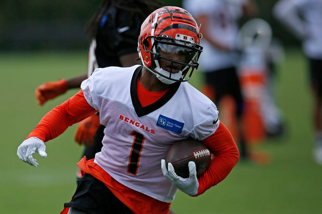 Cincinnati Bengals wide receiver Ja'Marr Chase (1) runs down field after a catch during a training camp practice at the Paul Brown stadium practice facility in downtown Cincinnati on Wednesday, Aug. 18, 2021.