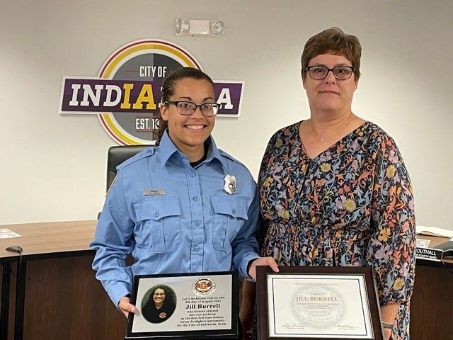 Indianola mayor Pam Pepper, right, celebrated the city's first female full-time firefighter and paramedic Jill Burrell, Aug. 16, 2021.