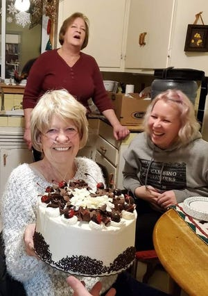 Judith Karinen celebrating her birthday while she was under treatment for cancer. Her daughter Connie is behind her and granddaughter Rachel on the right.
