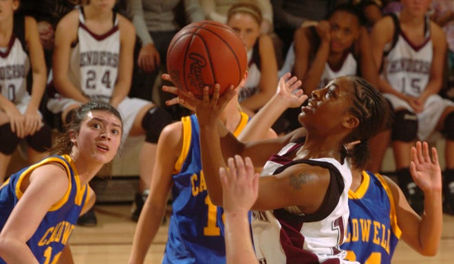 Henderson County's Rinesha Soaper takes the shot in a crowded lane during the Lady Colonels basketball game against Caldwell County in 2007.