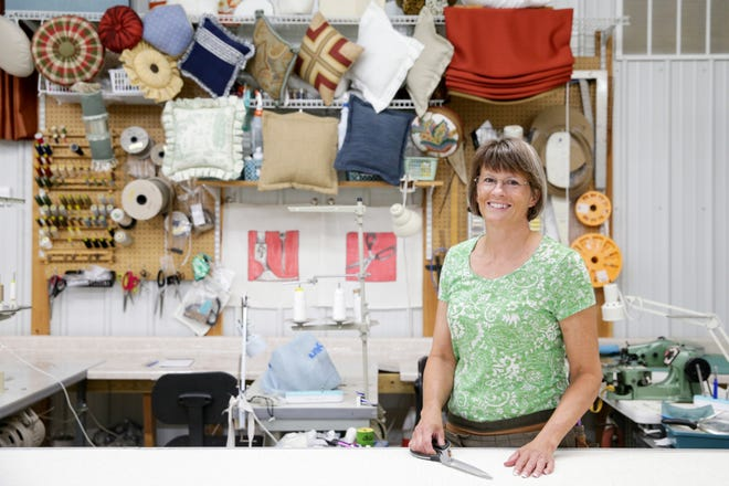 Laura Nelson, owner of Sew Nice, poses for a photo inside her studio, Wednesday, Aug. 18, 2021 in West Lafayette.