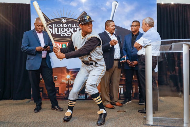 The Louisville Slugger Museum & Factory unveiled a lifelike sculpture of Major League Baseball Hall of Famer, Roberto Clemente, on Wednesday morning. Aug. 18, 2021. Two of Clemente's sons, Luis and Roberto Jr. are pictured to the immediate right of the statue.