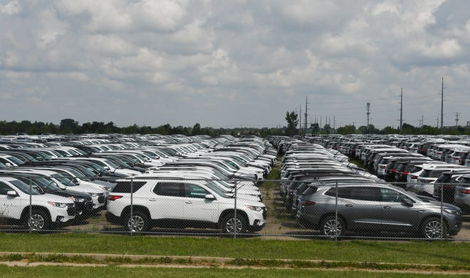 GM vehicles seen stored along Michigan Avenue near Rosemary Street in Lansing Township, Wednesday, Aug. 18, 2021.
