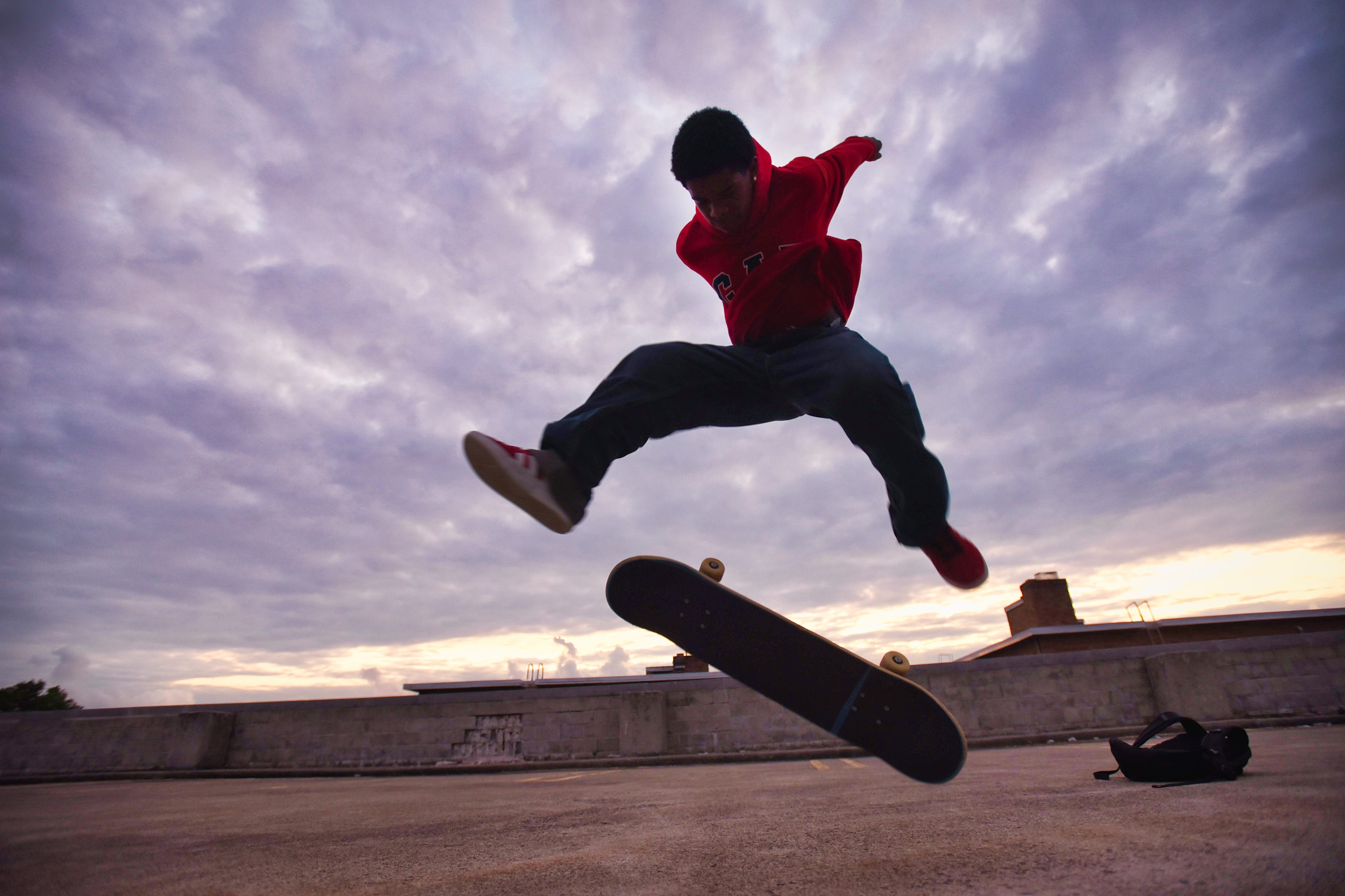 Zachary Hampton, 16, of Hackensack, practices skateboarding on the top roof of a parking garage as the sun sets in Hackensack on 08/04/21.