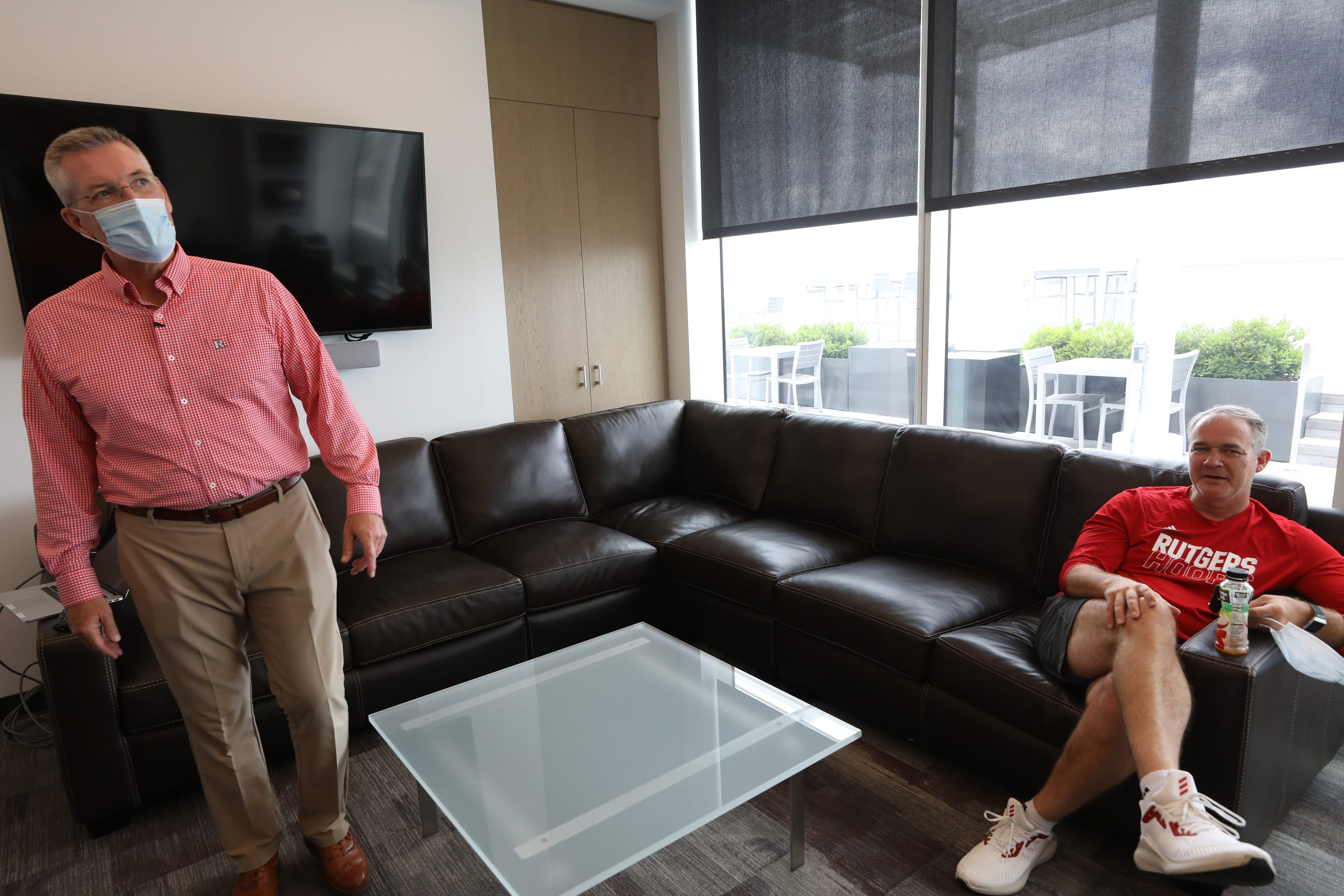 Rutgers Athletic Director Pat Hobbs with men's basketball coach Steve Pikiell in Pikiell's office in the RWJBarnabas Health Athletic Performance Center, one of two new athletic facilities on the campus of Rutgers University.