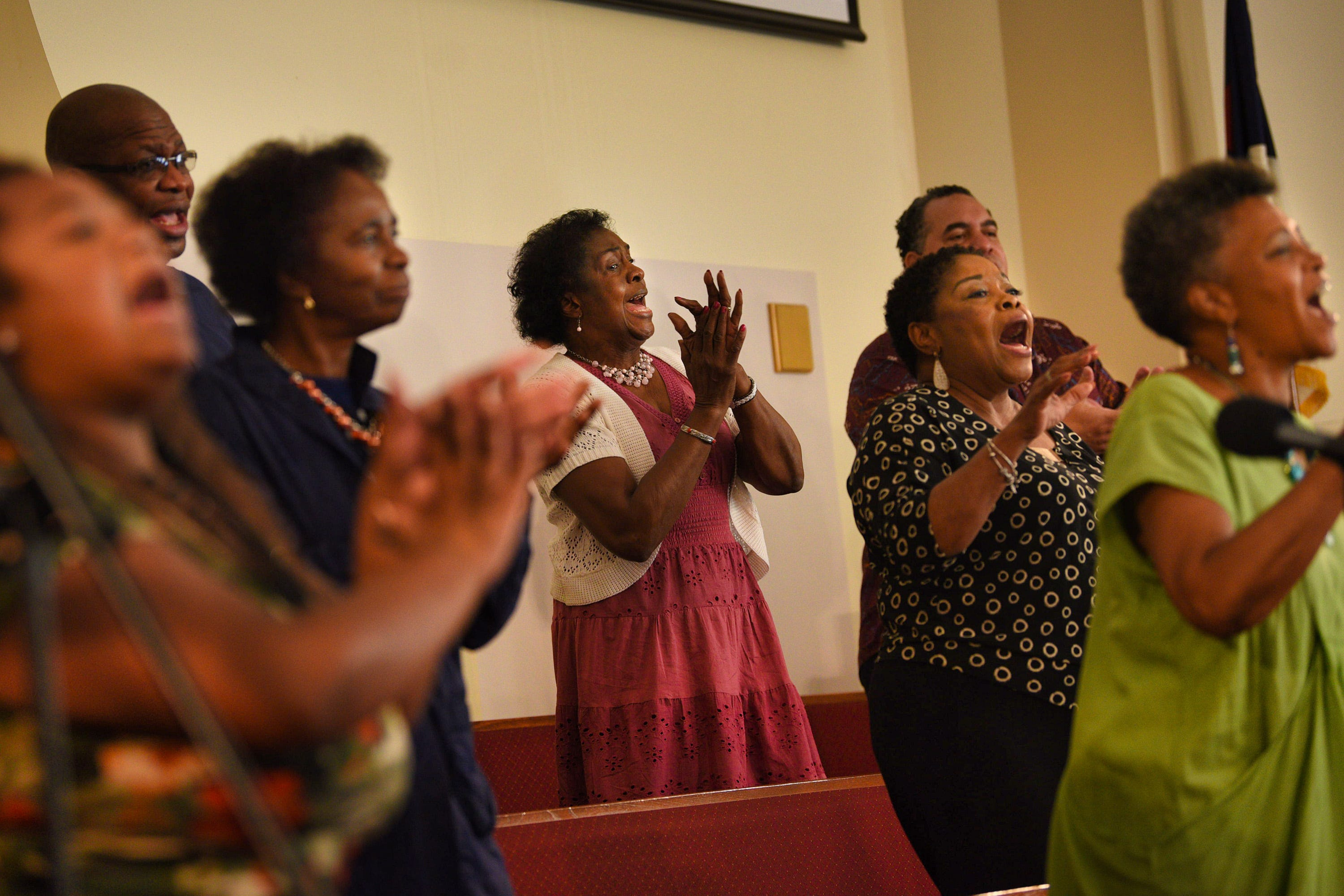 Mt. Olive Baptist Church choir members are socially distanced as they sing during the Sunday service at Mt. Olive Baptist Church In Hackensack on 08/15/21.