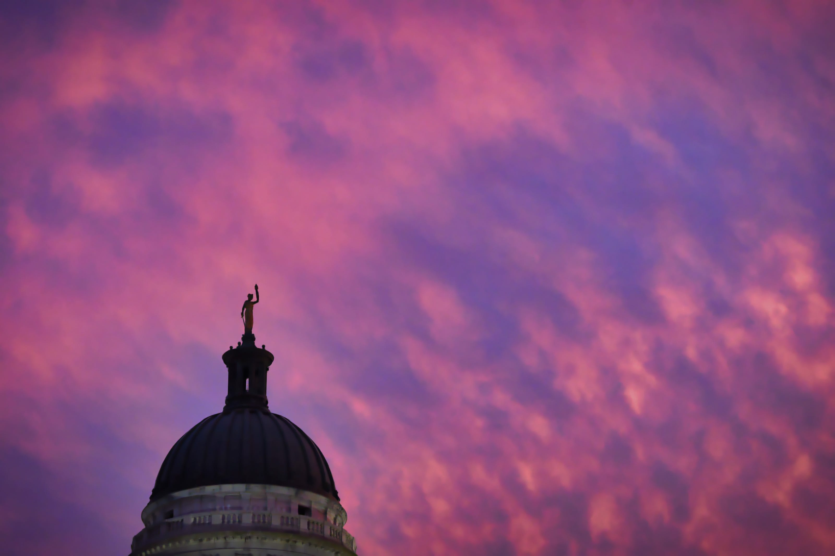 The dome atop the Bergen County Courthouse in Hackensack is seen against a colorful evening sky on 08/04/21.