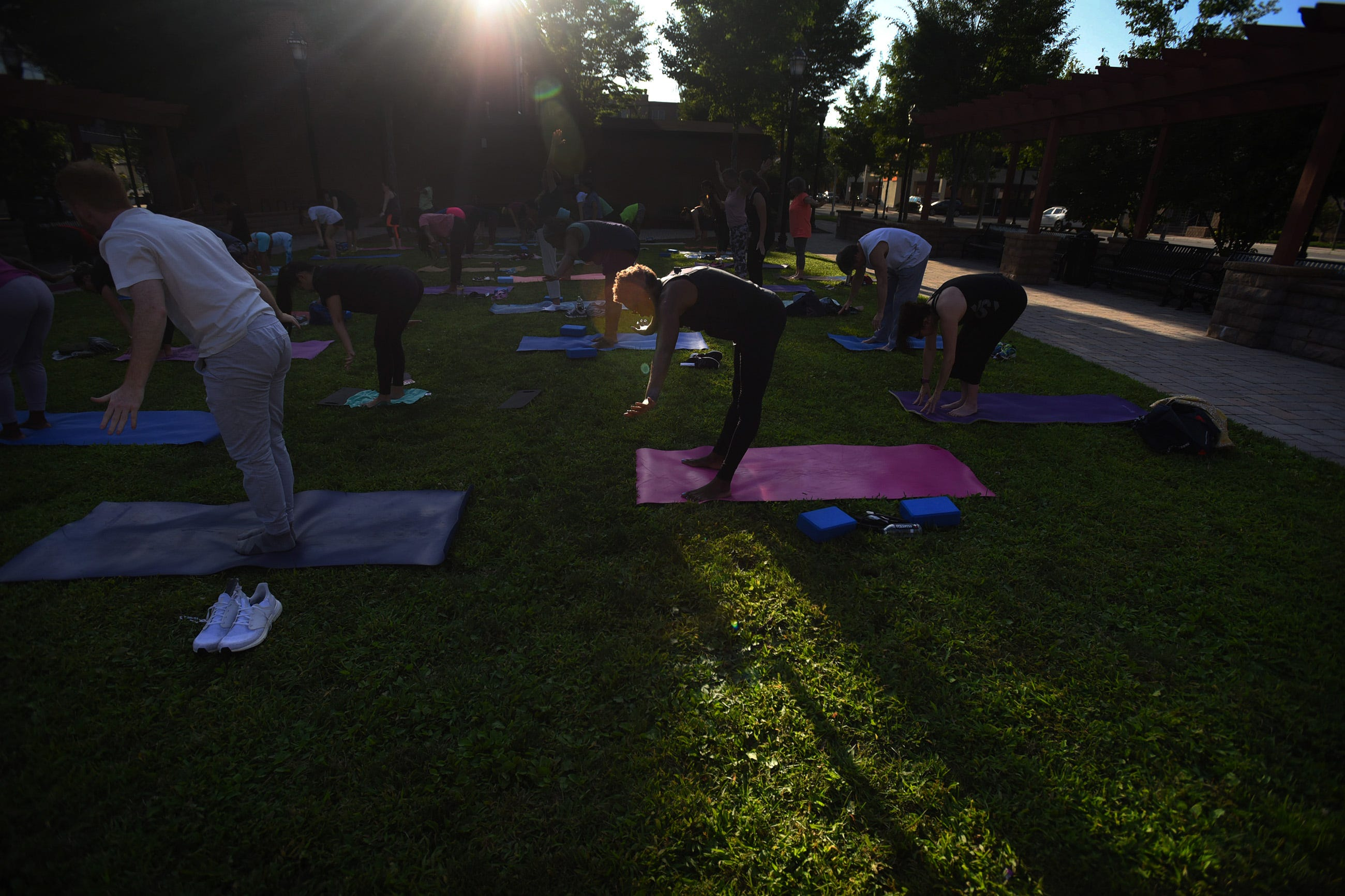 Hackensack resident Patricia Kinloch, 70, does sunset yoga in Atlantic Street Park just outside of the Hackensack Performing Arts Center on 08/02/21. It is one of many free-admission summer events hosted by HACPAC. Patricia has been doing Yoga for about 8 years.