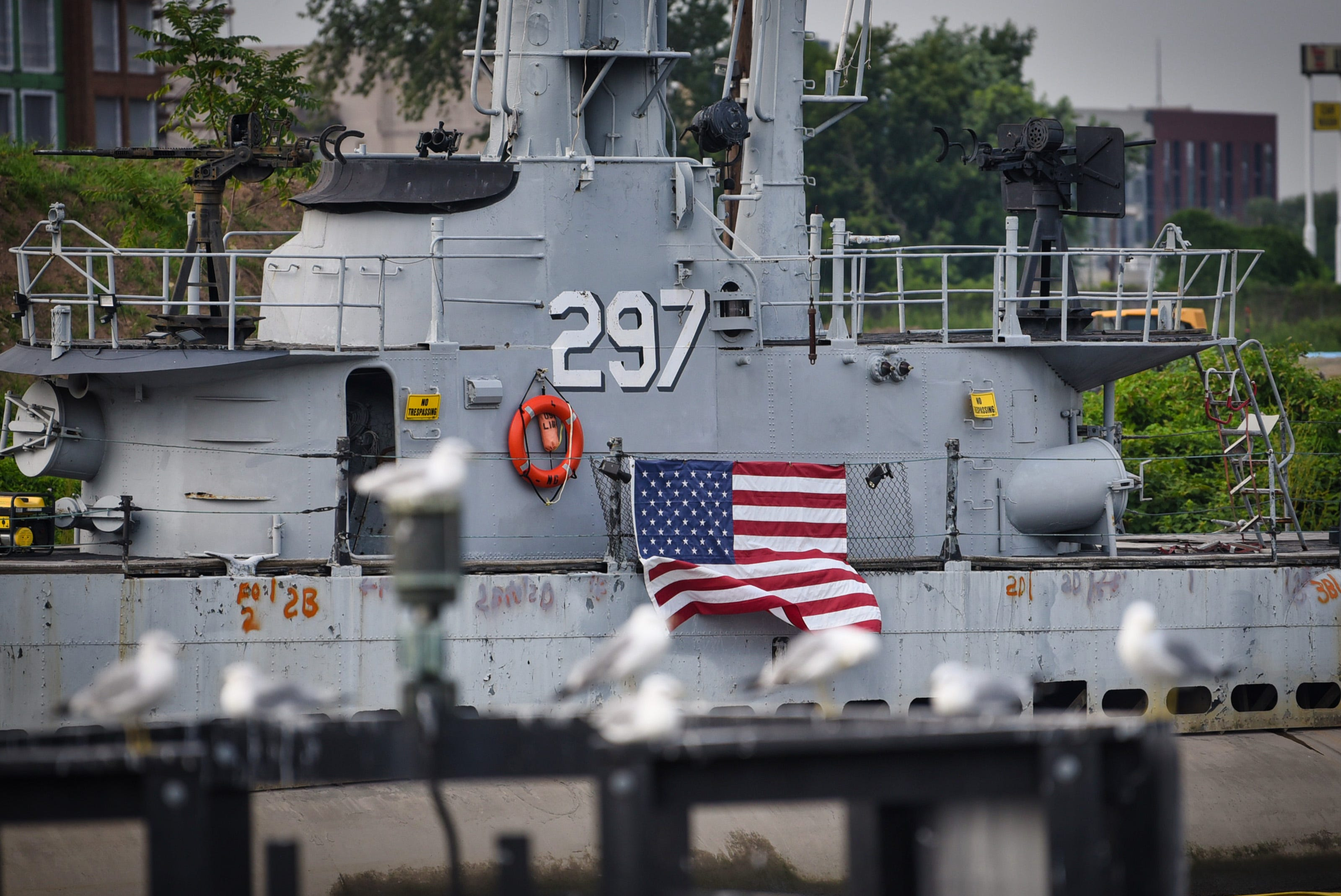 Seagulls line up in the foreground near the the USS Ling, a 312-foot long, 2,500-ton submarine veteran of World War II, which now rests on the silty bottom of Hackensack River. Photographed on 08/10/21.
