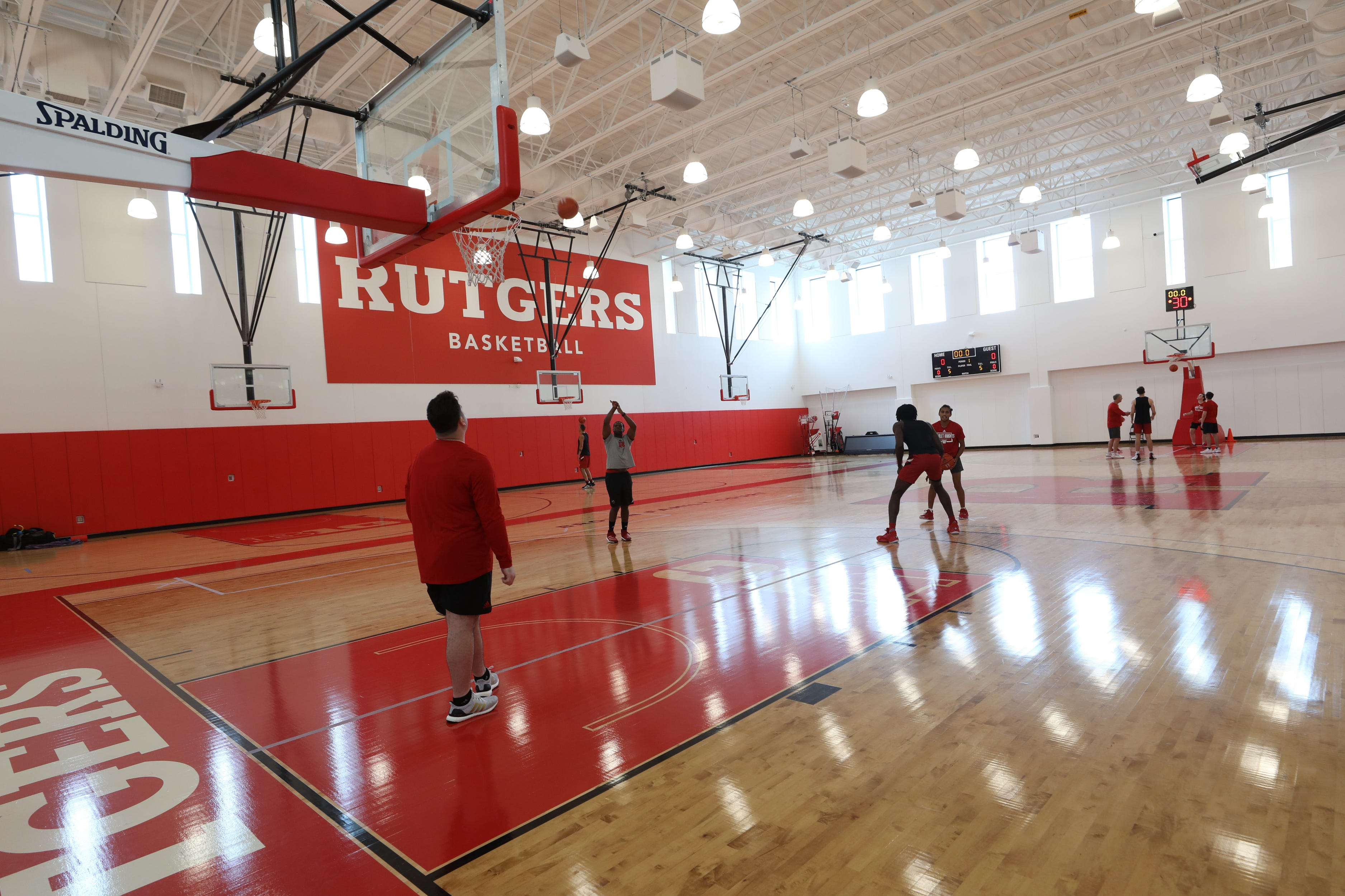The men's basketball practice gym of the RWJBarnabas Health Athletic Performance Center, part of two new athletic facilities on the campus of Rutgers University.