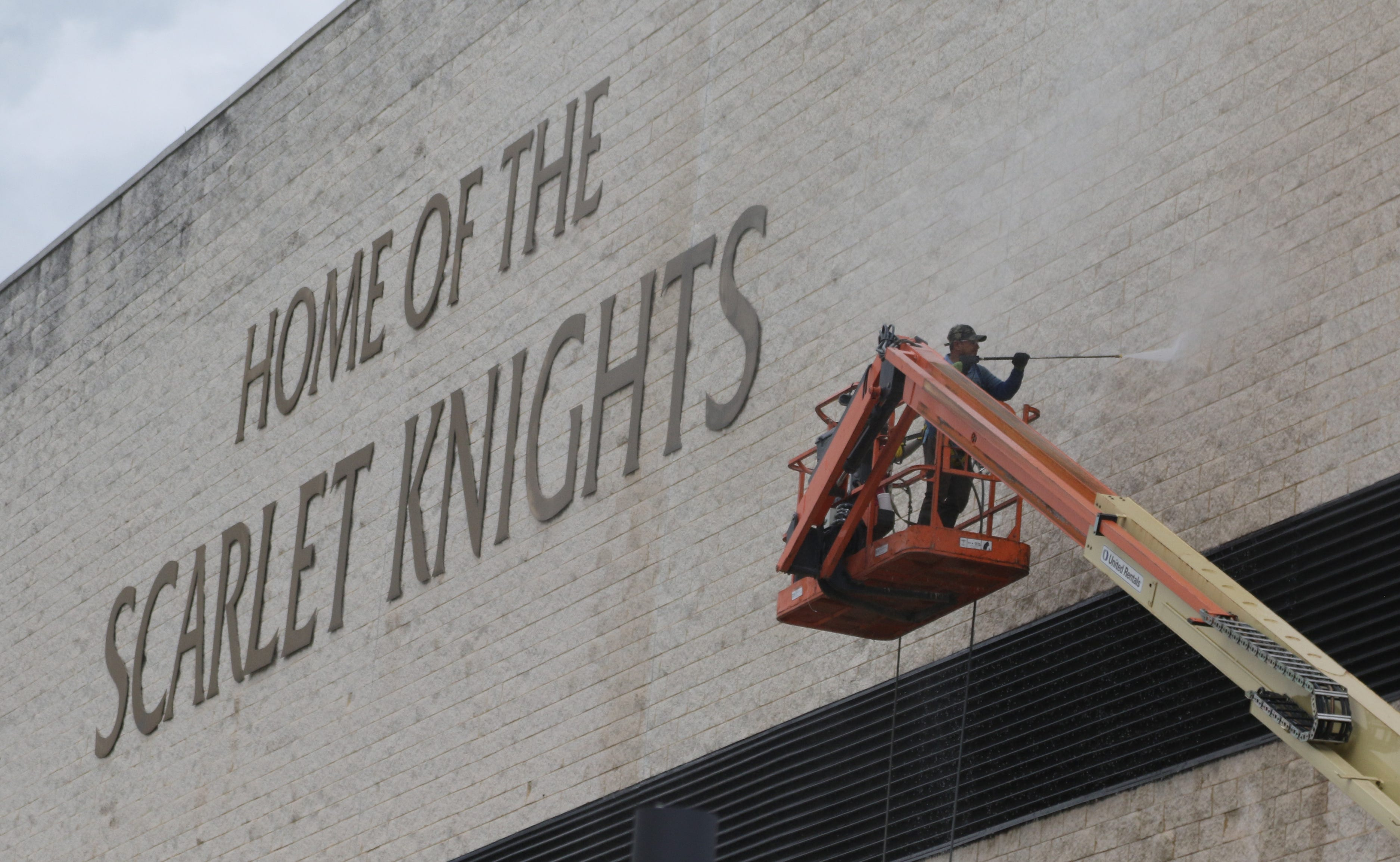 Cleaning the exterior of the Rutgers Athletic Center, one of the athletic department's older buildings as opposed to the two new athletic facilities on the campus of Rutgers University.