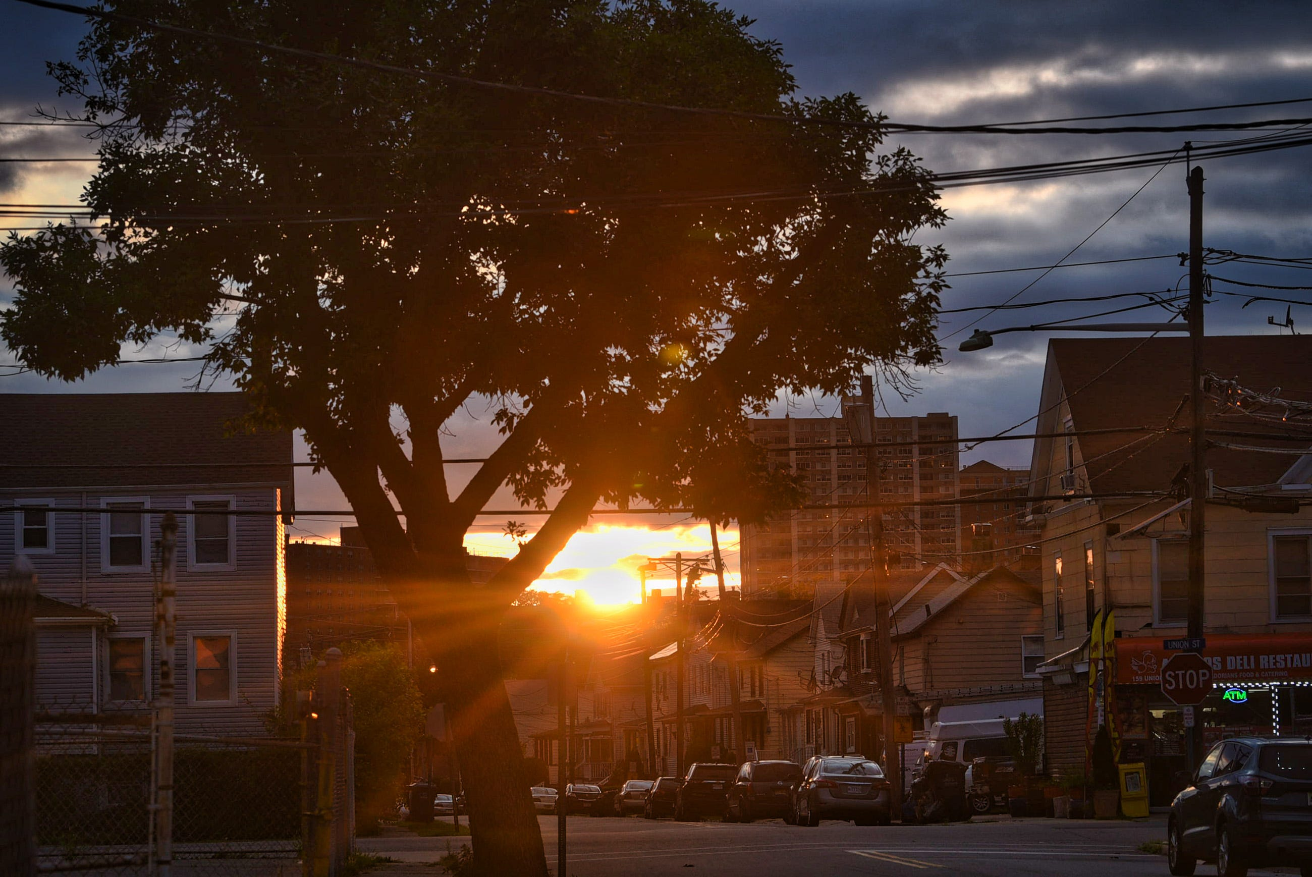 The sun begins to set behind the buildings at the corner of Union and Lawrence streets in Hackensack on 07/18/21.