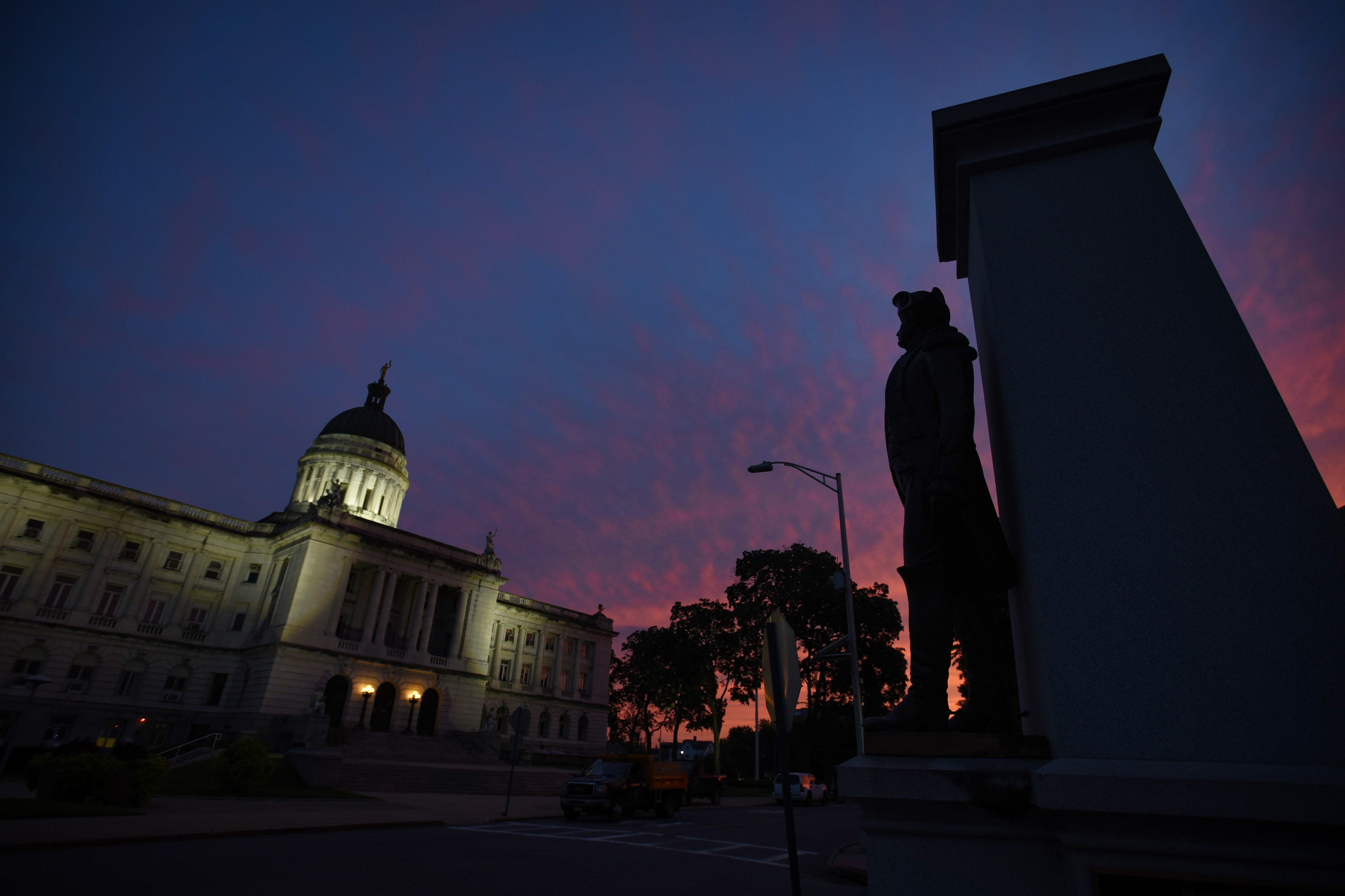 A colorful evening sky is seen above the Bergen County Courthouse and a statue of Brigadier General Enoch Poor on The Green in Hackensack on 08/03/21.