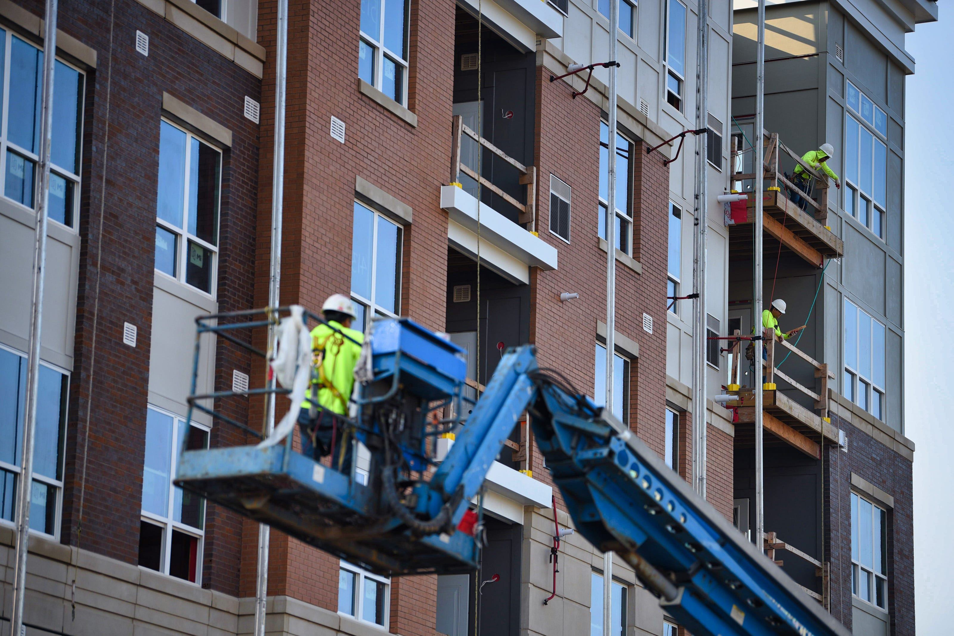 Construction workers at a luxury residential building project at the corner of Kinderkamack Road and Zabriskie Street in Hackensack on 08/12/21.