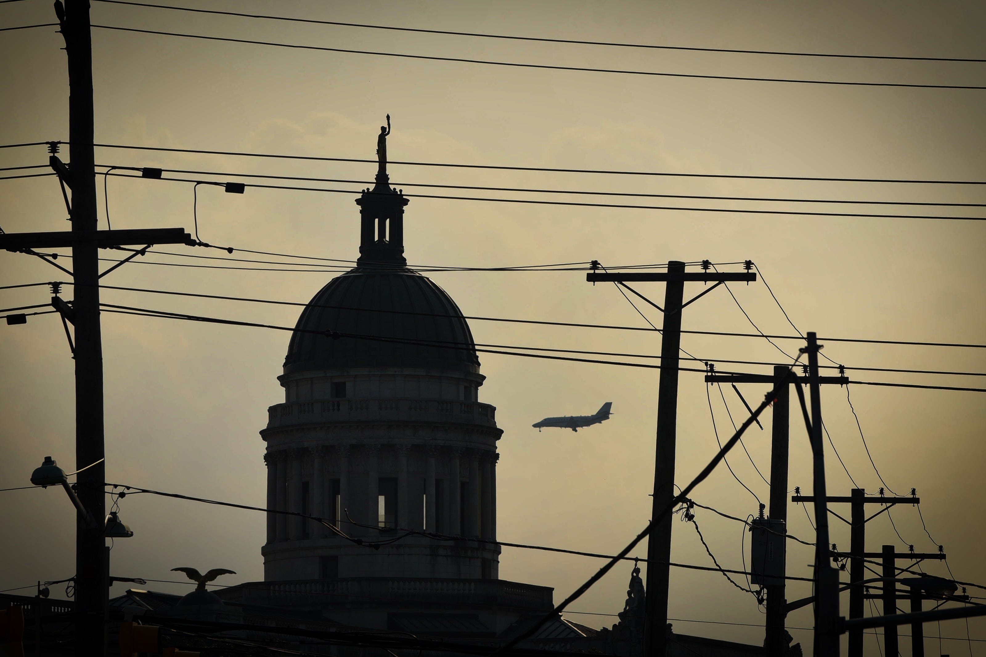 The dome atop the Bergen County Courthouse in Hackensack stands out against the late afternoon overcast sky as an airplane is seen in the sky on 08/04/21. The Courthouse was designed by J. Riely Gordon, and was constructed between 1909 and 1912.