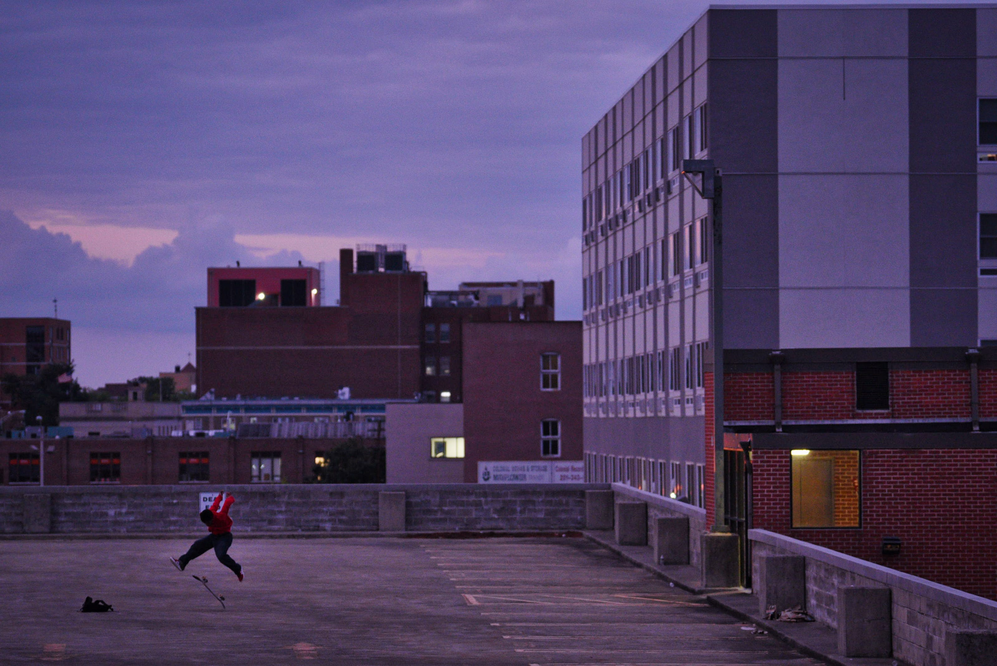 """""""It is relaxing and nobody is here,"""" says Zachary Hampton, 16, of Hackensack, who practices skateboarding on a parking garage roof as the sun sets in Hackensack on 08/04/21. He started skateboarding about a year ago. Zachary wants to become a film director or a real estate agent in the future."""