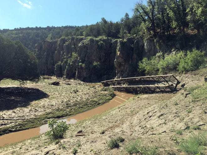 The Gila National ForestReserve Ranger District reports that the pedestrian bridge across the Tularosa River has been moved downstream due to flooding on July 23. The Walk in the Past Trail #616 is still open, and the ranger district recommends that all hikers proceed with caution when crossing the river. The Gila National Forest Engineering staff and the Reserve Ranger District are currently working towards getting the bridge reinstalled.