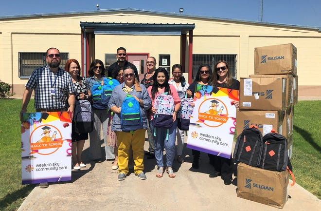 Deming Public Schools Department of Equity team accepting a generous donation of backpacks and school supplies from Western Sky Community Care.