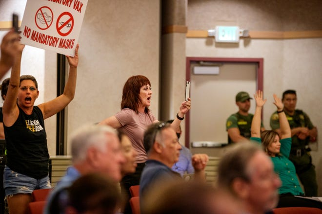 People shout during the Desert Sands Unified School District regular board meeting in La Quinta, Calif., on August 17, 2021.