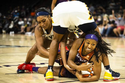 Phoenix Mercury guard Shey Peddy fights for possession Tuesday against the Indiana Fever.