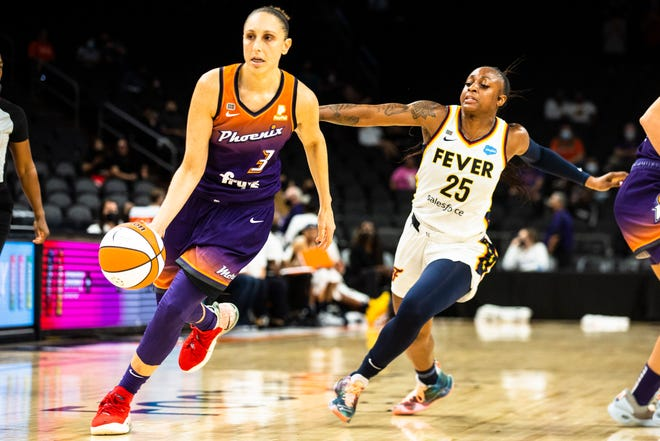 Phoenix Mercury guard and five-time olympic gold winner Diana Taurasi (3) drives against Indiana Fever guard Tiffany Mitchell (25) during the Mercury vs. Indiana Fever game at the Footprint Center in Phoenix, Aug. 17, 2021.