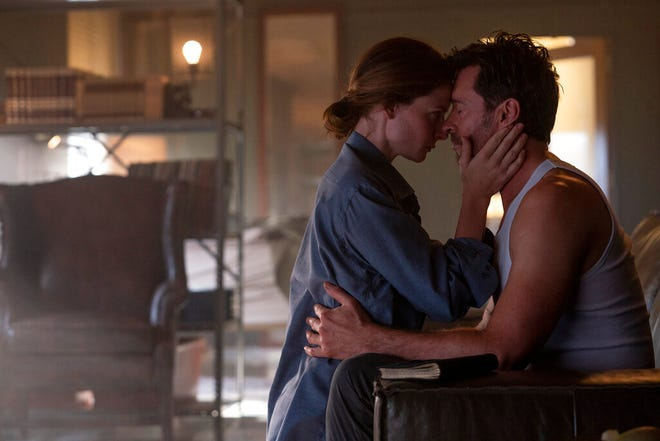 """Rebecca Ferguson, left, and Hugh Jackman star in """"Reminiscence."""" The movie opens Friday at Regal West Manchester, Queensgate Movies 13 and Hanover Movies 16 and on HBOMax."""