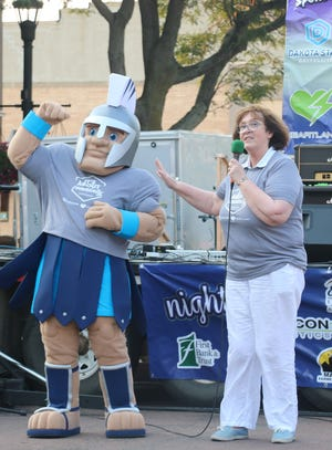 President José-Marie Griffiths (right) introduces General Cyber, Dakota State University's new mascot, to the Madison community Aug. 17.