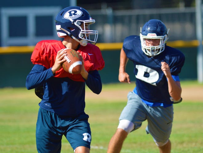 The Redwood High School football team practices on Aug. 10, 2021 in Visalia.