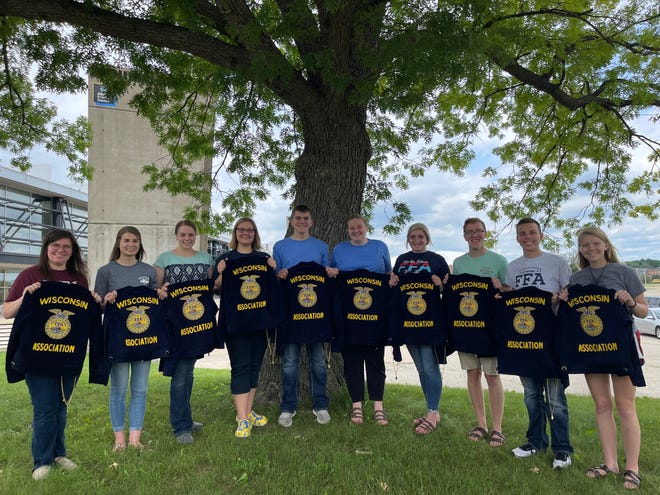 The 2020-2021 State FFA Officer team poses for a photo with the great oak at the Alliant Energy Center after the 92nd Wisconsin State FFA Convention concluded.