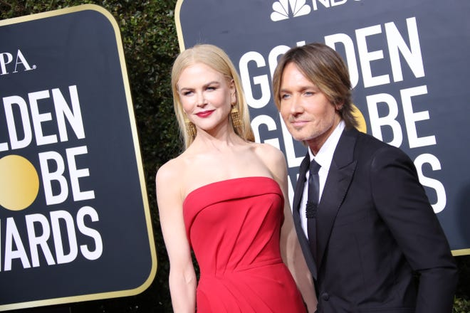 Nicole Kidman, left, and Keith Urban walk the red carpet at the 2020 Golden Globes in Beverly Hills, Calif.