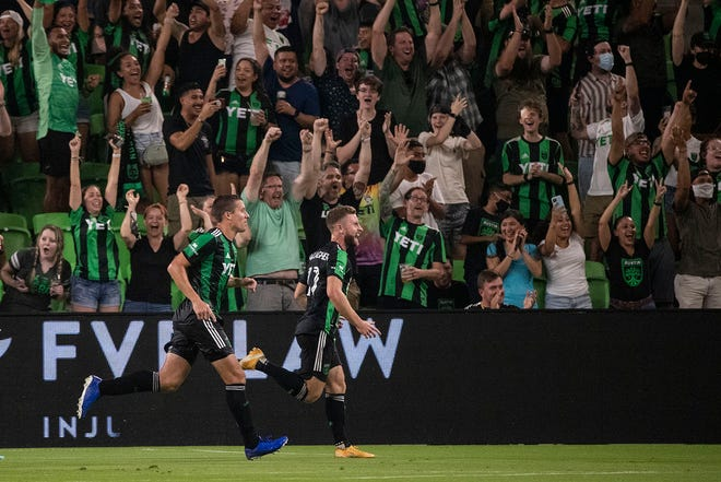 Austin FC cheers after scoring during a match against Vancouver Whitecaps FC at Q2 Stadium in Austin, Texas on Wednesday, August 18, 2021.