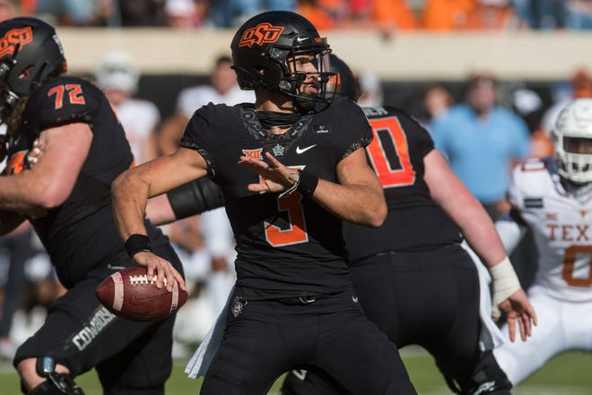 Oklahoma State quarterback Spencer Sanders doesn't get the attention that fellow Big 12 passer Spencer Rattler does at rival Oklahoma, but his play is expected to tell the tale of whether the Cowboys can crack the top two in the conference.