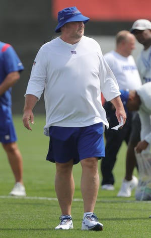 Former Browns coach Freddie Kitchens, now the New York Giants senior offensive assistant, roams the field during a joint practice on Thursday in Berea. [Phil Masturzo/ Beacon Journal]