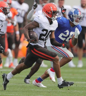 Browns Greg Newsome II intercepts a pass against the NY Giants during a joint practice on Thursday, August 19, 2021 in Berea, Ohio, at CrossCountry Mortgage Campus. [Phil Masturzo/ Beacon Journal]