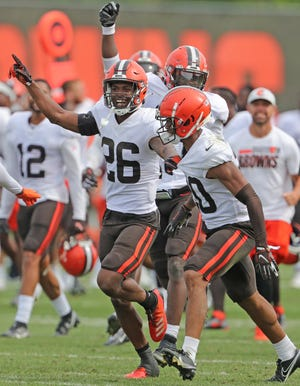 Browns cornerback Greedy Williams (26) suffered a groin injury in the preseason game against the New York Giants on Sunday and that could lead to rookie Greg Newsome II, right, to start the opener against the Kansas City Chiefs on Sept. 12. [Phil Masturzo/ Beacon Journal]